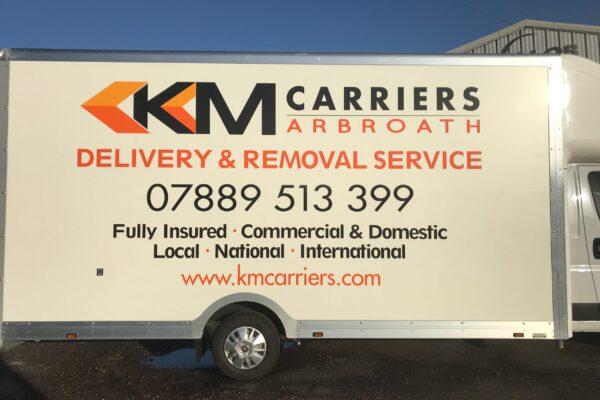 Side of KM Carriers van