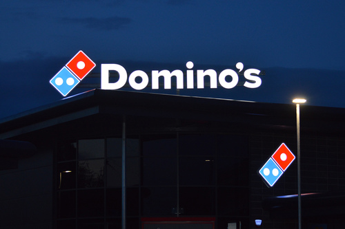 dominos sign in the dark