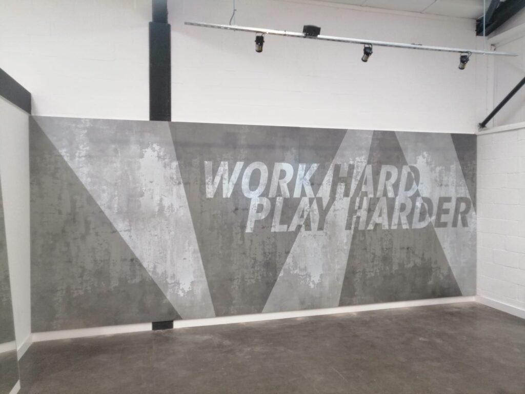 Grey work hard play harder wall design