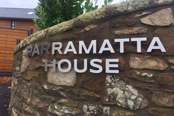 Parramatta house logo fitted on a wall
