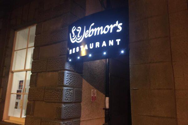 webmors restaurant logo at night