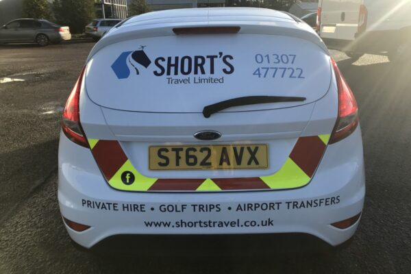 Back of Shorts Travel vehicle livery
