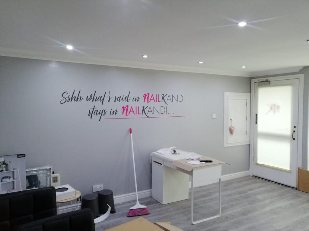 pink text on a wall