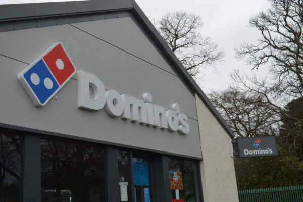Outside dominos signs