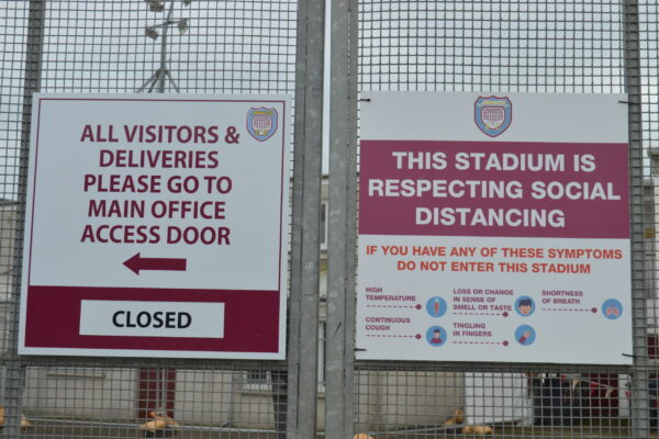 Signs outside the stadium informing fans
