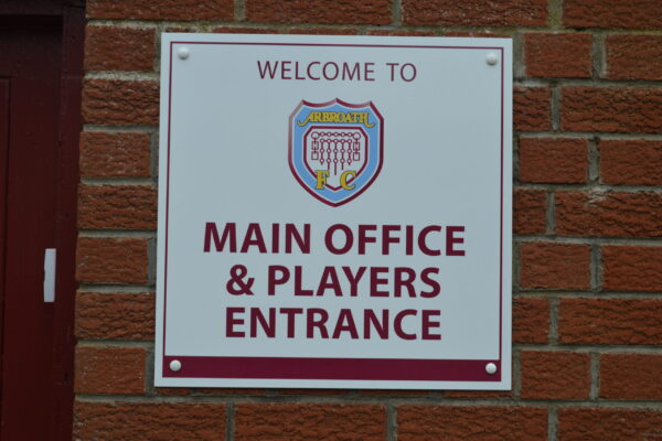 Main office and players entrance sign