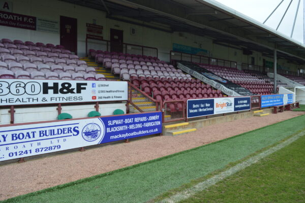 Seating stand with advertising boards at Gayfield