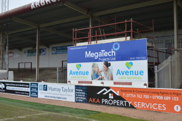 Mega Tech advertising board at Gayfield