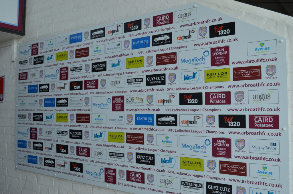 White wall of sponsors at Arbroath